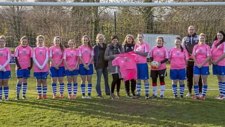 Sharon Jenkins, accompanied by Rachel Hollox, presented the training tops to the Ottery ladies side.