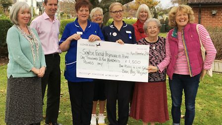 Pictured at the cheque presentation are (l to r) Kirstine House, Dr Mark Welland, Hazel Barber, Gill