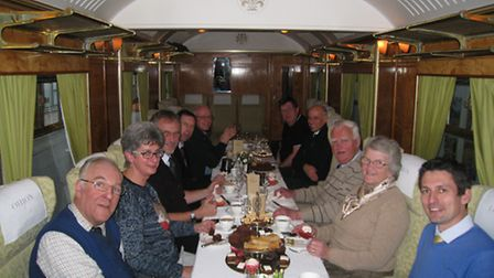 Mike Davis, seated in the middle on the right next to his wife Pam had a surprise high tea thrown by