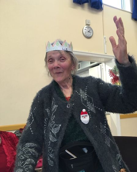 Queen Liz gives the royal wave while volunteers set up the speakers for the Queens Speech.