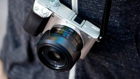 The camera is similar to this Sony a6000 with a black 35mm lens