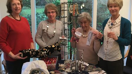 Cathy Badley, Pam Joy, Vi Killip and Jo Moorhouse pose with a selection of the jewellery they and ot