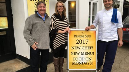 Tom Entwisle, new chef at The Rising Sun, Sidford, is pictured with landlords Andy and Lisa Downham.