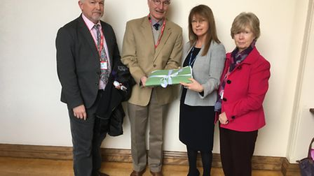 Petition opposing bed cuts handed to CCG associate Jenny McNeill (second from right) by chairman of
