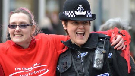 Dancer and policewoman at previous One Billion Rising event