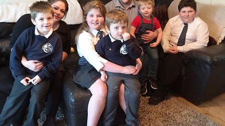Claire Fuller and partner Bruce Farrell with their children