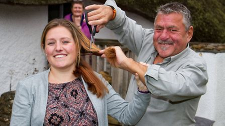 Michael Wolfenbale and his daughter Faye Thompson before having their hair shaved off whilst Gillian