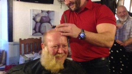 Robbie Drew mid-shave as he raises more than £2,000 for charity.