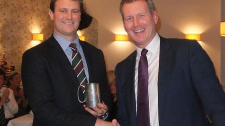 1st XI batsman of the year Liam Lewis collecting his award from Jay Thorne of Harrison Lavers and P