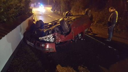 Emergency services were called to Sidmouth's Bulverton Road when a car overturned and the driver b