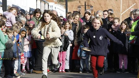 Sidmouth Pancake races. Ref shs 3178-08-15TI. Picture: Terry Ife
