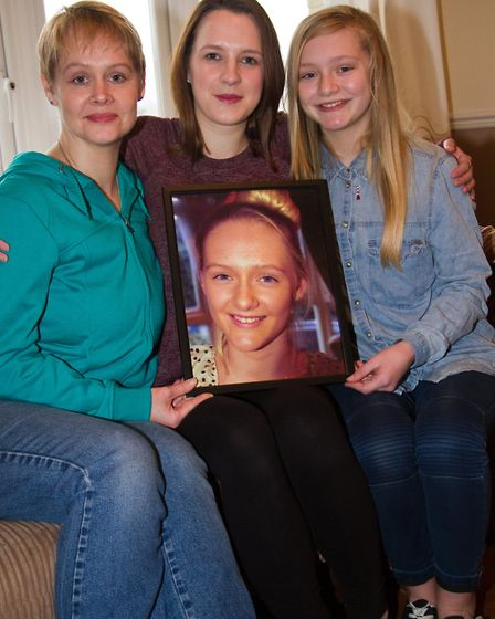 Emma and Alisha Moth and family friend Charlotte Vincent with a picture of Paige. Ref sho 07-17TI 72