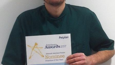 Owner of Sidmouth Veterinary Practice, Richard Jones, holding the nominations.