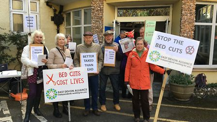 Protesters gather in Sidmouth outside public meeting to discuss proposed bed cuts