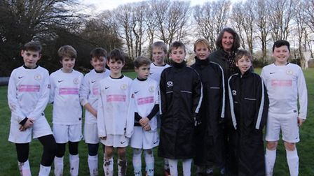 Sidmouth Raiders Under-12s team with the waterproof substitute jackets that have been provided by sp