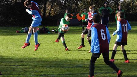 Ben Elsom fires the ball towards goal during the Sidmouth Warriors U11 3-1 win over North Tawton