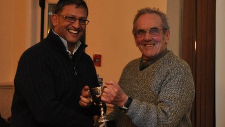Sidmouth's Saj Patidar collecting the Premier 2nd XI winners' trophy from league president Graham Sh