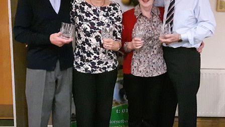 Evan and Bev Williams together with Pam and Colin Palmer of Sidbury Short Mat Bowls Club, who won th