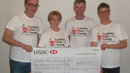 John Keast, Marion Hayman, Robert Hayman and Dr Nick Read with the cheque for £1,289.