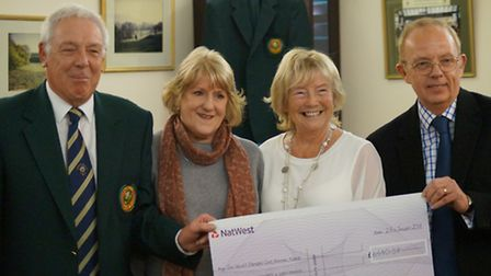 Ray Gunston, men's captain, presents a cheque of more than £6,000 to the Admiral Nurse campaign.