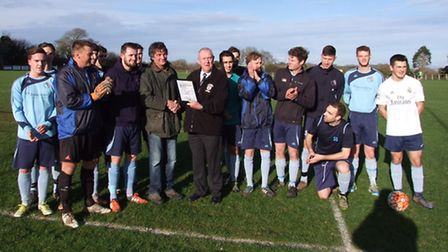 Beer FC groundsman Peter Adkin is presented with the Devon County FA Groundsman of the Year award by