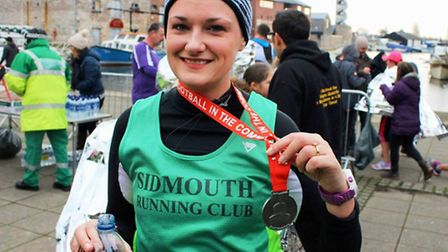 Sidmouth Running Club member Emma Salter with her medal from the Exeter Half Marathon