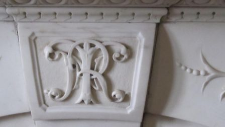 The initials of Richard Napoleon Thornton on a fireplace at Knowle, his former home