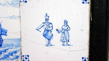 A tile at Knowle depicting a drummer
