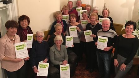 The Sidmouth and District Macmillan Cancer Support Fundraising Committee gathered for one last time