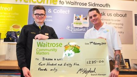 Mike Rock collecting a cheque from Waitrose for Dream-a-Way