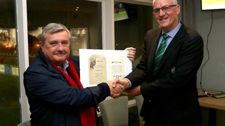 Sidmouth RFC's Lester Willmington accepts the programme dating from 1932 from Andy Argyle from the S