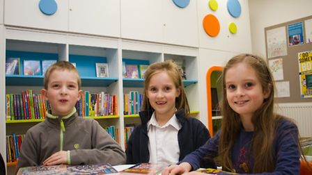 James, Charlotte and Emily Arkinstall a t the Ottery library drop-in session. Ref sho 09-17TI 7968.