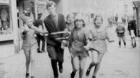 Ottery Pixie Day, June 1971. A bell ringer is captured by the troublesome pixies and paraded thorugh
