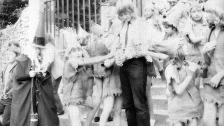 Ottery Pixie Day, June 1971. A bell ringer is captured and lead from the church. Ref sho Pixie Day 1