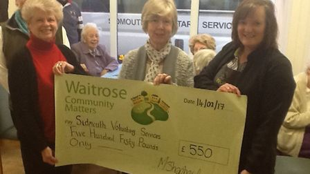 Sidmouth Voluntary Services recieves £550 donation from Waitrose Community Matters Pictured from