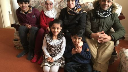 Syrian refugee family thanked Sidmouth for warm welcome Back L - R: Jawad, Shahed, Wafaa, Mazen