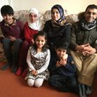 Syrian refugee family thanked Sidmouth for warm welcome Back L - R: Jawad, Shahed, Wafaa, Mazen Fr