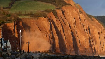 Red dust is sent into the air following yet another cliff fall, this one took place at 5.30pm on Sat