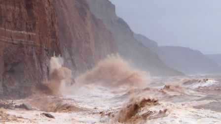 Waves crash into Sidmouth's cliffs. Picture: Eve Mathews.