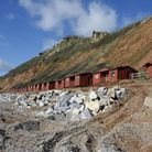 Work being done in front of the chalets on the west end of Branscombe beach. Photo by Terry Ife. Ref