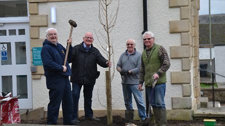 Councillors Ian Holmes and Mayor Glyn Dobson joined Brian Nelson to plant the trees outside the new