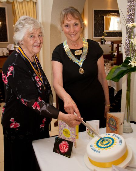 President of The Inner Wheel Hilary Hatherley with District Chairman Diedre Stewart cutting the cake