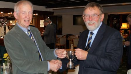 Sidmouth seniors captain Bruce Harcourt presents the Eclectic Cup to Phil Spencer