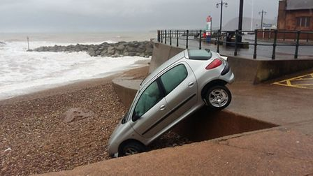 Paul Taylor took these photos of a car that dropped down onto the beach this morning (Wednesday)