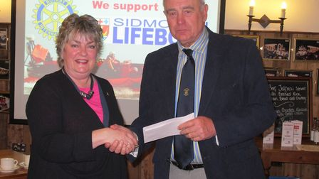 Sally Wilcox, Sid Valley Rotary President, John Fowler, Chairman Sidmouth Lifeboat – receiving chequ