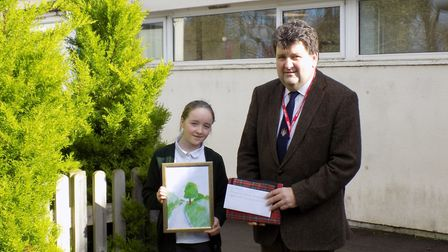 Ottery schoolgirl Lyra Henderson with Councillor Iain Chubb. Lyra's drawing of the Land of Canaan wa