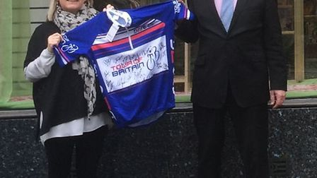 Sidmouth Chamber of Commerce chairman David Wheaton presenting the autographed top to Hospiscare's D