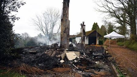 The remains of a cottage in Newton Poppleford after a thatch roof fire. Picture: GRAHAM MILLS