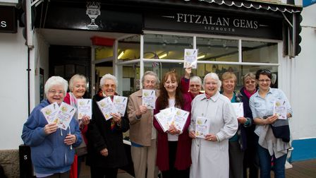 Anne Barratt with friends of Jeanne Selley outside Fitzalan Gems with the poetry book. Ref shs 13-17