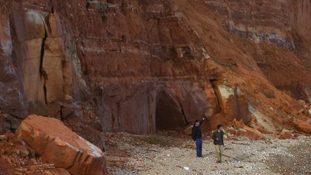 People under the eroding cliffs at East Beach, Sidmouth. Ref shs cliff hangers SH-13-17-04. Picture: